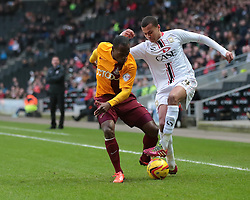 Milton Keynes Dons' Dele Alli is challenged by Bradford City's Kyel Reid - Photo mandatory by-line: Nigel Pitts-Drake/JMP - Tel: Mobile: 07966 386802 23/11/2013 - SPORT - Football - Milton Keynes - Stadium MK - Milton Keynes v Bradford City - Sky Bet League One