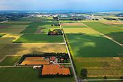 Nederland, Noordoostpolder, 30-06-2011; Karel Doormanweg (gezien naar Emmeloord). De Noordoostpolder (NOP), is een voorbeeld van moderne grootschalige polder met rationele verkaveling. De aanleg van de polder maakte  deel uit van de Zuiderzeewerken (plan Lely) en viel in 1942 droog. De meeste boerderijen (en dorpen) zijn van na de tweede wereldoorlog..The northeast polder (NOP), is an example of modern large-scale polder with rational allotment. The construction of the polder was part of the Zuiderzee Works (Lely plan), in 1942 the polder was dry. Most of the building, farmhouses and villages, is post-war..luchtfoto (toeslag), aerial photo (additional fee required).copyright foto/photo Siebe Swart