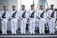 The honour guard stands to attention aboard the Chinese Naval assault ship Chang Bai Shan at Portsmouth Royal Navy Base today. The ship is involved in the first visit by the Chinese Navy to the UK since 2007 and the largest ever. She is accompanied by the frigate Yun Cheng and the replenishment ship Chaohu. The ships arrived in Portsmouth 24 hours early due to the expected bad weather. The Royal Navy statement stated that the five day formal visit is aimed at enhancing military understanding between the UK and China. Picture date Monday 12th January, 2015.<br /> Picture by Christopher Ison. Contact +447544 044177 chris@christopherison.com