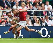 Wales' Liam Williams is tackled by England's Anthony Watson during the The Old Mutual Wealth Cup match England -V- Wales at Twickenham Stadium, London, Greater London, England on Sunday, May 29, 2016. (Steve Flynn/Image of Sport)