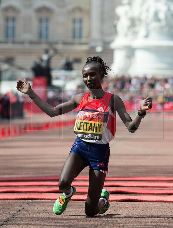 © London News Pictures. 22/04/2012. London, UK. Mary Keitany of Kenya celebrates winning the women's elite race during the 2012 Virgin London Marathon on April 22, 2012. Photo credit : Ben Cawthra /LNP