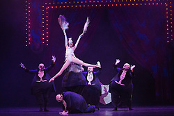 © Licensed to London News Pictures. 18/03/2015. London, England. Pictured: Dress rehearsal of Carmina burana, music by Carl Orff with choreography by David Bintley. Section: In The Tavern with Jenna Roberts as Roast Swan.  Birmingham Royal Ballet celebrates its 25th anniversary in 2015 with performances of Serenade and Carmina Burana at London Coliseum, 19-21 March 2015. Photo credit: Bettina Strenske/LNP