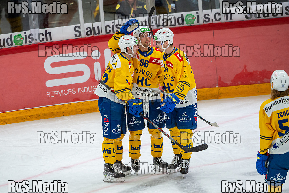 LAUSANNE, SWITZERLAND - SEPTEMBER 24: Yannick Frehner #93 of HC Davos celebrates his goal with teammates during the Swiss National League game between Lausanne HC and HC Davos at Vaudoise Arena on September 24, 2021 in Lausanne, Switzerland. (Photo by Robert Hradil/RvS.Media)