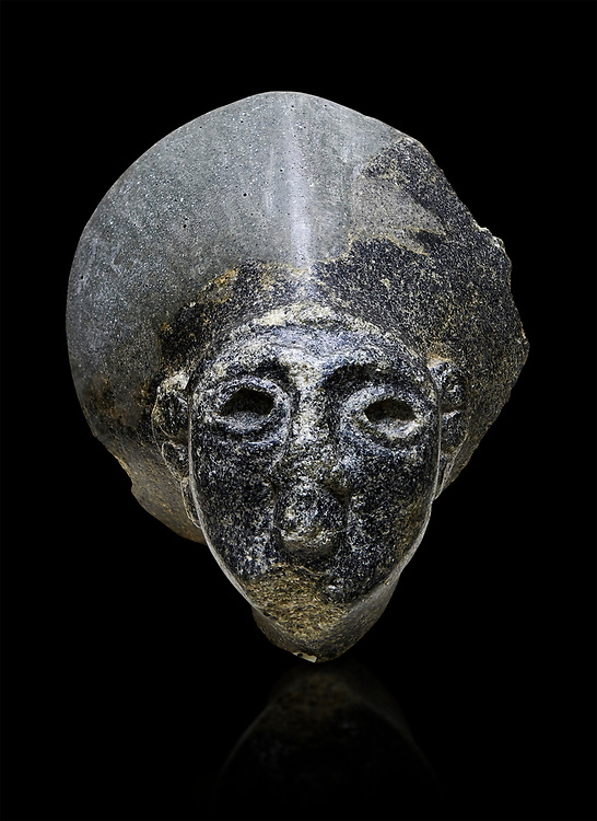 Hittite statue head of the Sun Goddess . Basalt, Hittie Period 1650 - 1450 BC. Hattusa Boğazkale. Çorum Archaeological Museum, Corum, Turkey. Against a black bacground. .<br />  <br /> If you prefer to buy from our ALAMY STOCK LIBRARY page at https://www.alamy.com/portfolio/paul-williams-funkystock/hittite-art-antiquities.html  - Type Hattusa into the LOWER SEARCH WITHIN GALLERY box. Refine search by adding background colour, place,etc<br /> <br /> Visit our HITTITE PHOTO COLLECTIONS for more photos to download or buy as wall art prints https://funkystock.photoshelter.com/gallery-collection/The-Hittites-Art-Artefacts-Antiquities-Historic-Sites-Pictures-Images-of/C0000NUBSMhSc3Oo