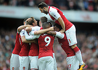 Football - 2017 / 2018 Premier League - Arsenal vs. Brighton & Hove Albion<br /> <br /> Sead Kolasinac of Arsenal joins in the celebrations for Nacho Monreal's goal at The Emirates.<br /> <br /> COLORSPORT/ANDREW COWIE