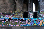 Street art in the old industrial area and railway arches of Digbeth on 14th December 2020 in Birmingham, United Kingdom. Following the destruction of the Inner Ring Road, Digbeth is now considered a district within Birmingham City Centre, and is the epicentre for arts and graffiti artworks as well as its status as a once-gritty bohemian district known for street art and a young and hip people attending events and creative workshops at the Custard Factory and grungy clubs in former warehouses. As part of the Big City Plan, Digbeth is undergoing a large redevelopment scheme that will regenerate the old industrial buildings into apartments, retail premises, offices and arts facilities. There is still however much industrial activity in the south of the area.