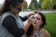 Asian model has her make up done my a make up artist prior to a photo shoot at Jubilee Gardens. The South Bank is a significant arts and entertainment district, and home to an endless list of activities for Londoners, visitors and tourists alike.