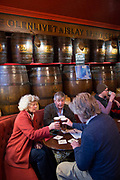 Firends toast one another over pints of real ale at Kays Bar on the 9th November 2018 in Edinburgh, Scotland in the United Kingdom. A cosy Victorian pub with wooden barrel decor and a library for guest draught beers and plain lunches.