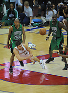 Cleveland's Wally Szczerbiak passes out of a double team by Boston's Ray Allen and Kevin Garnett.
