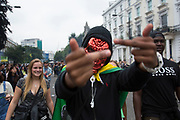 New arrivals. People arriving later in the afternoon along Kensington Park Road. Notting Hill Carnival in West London. A celebration of West Indian / Caribbean culture and Europe's largest street party, festival and parade. Revellers come in their hundreds of thousands to have fun, dance, drink and let go in the brilliant atmosphere. It is led by members of the West Indian / Caribbrean community, particularly the Trinidadian and Tobagonian British population, many of whom have lived in the area since the 1950s. The carnival has attracted up to 2 million people in the past and centres around a parade of floats, dancers and sound systems.