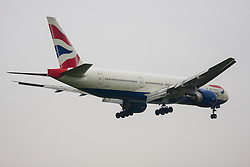 London Heathrow Airport, November 16th 2014. A British Airways Boeing 777-200 ER reg G-VIIJ lands on Heathrow Airport's Runway 09L.