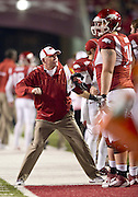 Nov 12, 2011; Fayetteville, AR, USA; Arkansas Razorback head coach Bobby Petrino reacts to a play as offensive tackle Brey Cook (74) looks on during a game against the Tennessee Volunteers at Donald W. Reynolds Razorback Stadium. Mandatory Credit: Beth Hall-US PRESSWIRE