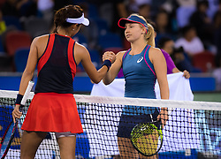 September 26, 2018 - Qiang Wang of China & Daria Gavrilova of Australia at the net after their third-round match at the 2018 Dongfeng Motor Wuhan Open WTA Premier 5 tennis tournament (Credit Image: © AFP7 via ZUMA Wire)
