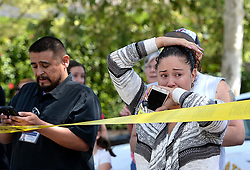 Apr 10, 2017 - San Bernardino, California, U.S. - Parents and family of North Park Elementary School students stand across the street from the school waiting to hear from their children. Multiple law enforcement agencies responded to North Park Elementary school in San Bernardino, where two people are dead and two children wounded in a shooting 'Two adults are deceased in a classroom, believed to be a murder-suicide,' San Bernardino Police Chief Jarrod Burguan posted on Twitter. One of the victims is a teacher, according to Maria Garcia, a spokeswoman for San Bernardino City Unified. Two students have been taken to a nearby hospital, according to Burguan. (Credit Image: © Rick Sforza/San Bernardino Sun via ZUMA/ZUMAPRESS.com)