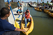 Alviso native Seth Ruiz, 11, and his mom Sarah load into a kayak to explore the marsh more closely during Santa Clara County Park's Day on the Bay event at Don Edwards San Francisco Bay National Wildlife Refuge in Alviso, California, on October 9, 2016. (Stan Olszewski/SOSKIphoto)