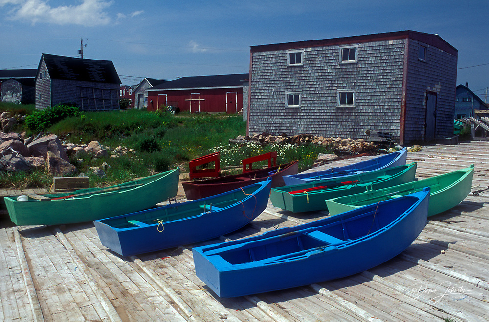 Colourful dories pulled up on ramp at Cape Breton fishing village, Neil's harbour, NS, Canada
