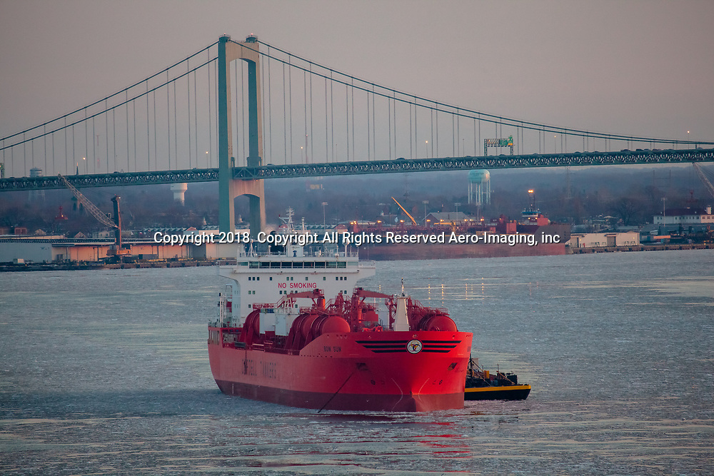 Aerial view of The Bow Sun Vessel, Odfjell  tanker in the Icy waters of the Delaware River, Penns Landing and Camden, New Jersey in background, with the Walt Whitman Bridge,
