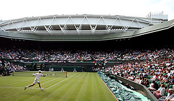 Kyle Edmund (near court) in action against Jaume Munar on centre court on day one of the Wimbledon Championships at the All England Lawn Tennis and Croquet Club, Wimbledon.