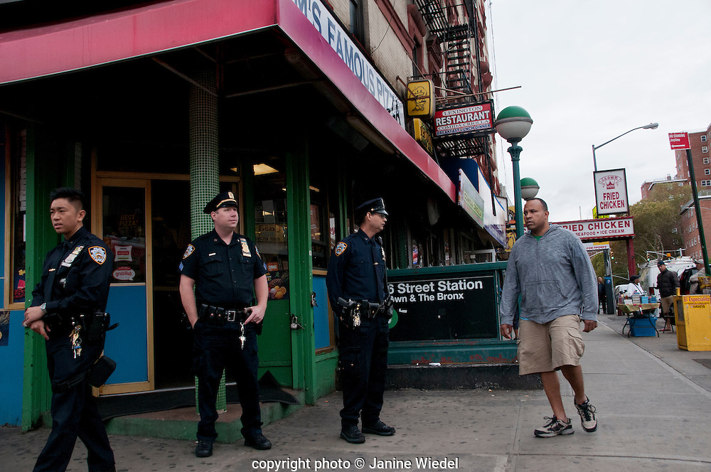 NYC cops patrolling in Harlem New York City streetsstreets