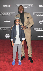 December 10, 2016 - Los Angeles, CA, United States of America - Terry Crews and Isaiah Crews arriving at the Star Wars ''Rogue One'' World Premiere at the Pantages Theater on December 10 2016 in Hollywood, CA  (Credit Image: © Famous/Ace Pictures via ZUMA Press)