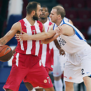 Anadolu Efes's Sinan GULER (R) and Olympiacos's Vassilis SPANOULIS (L) during their Two Nations Cup basketball match Anadolu Efes between Olympiacos at Abdi Ipekci Arena in Istanbul Turkey on Sunday 02 October 2011. Photo by TURKPIX