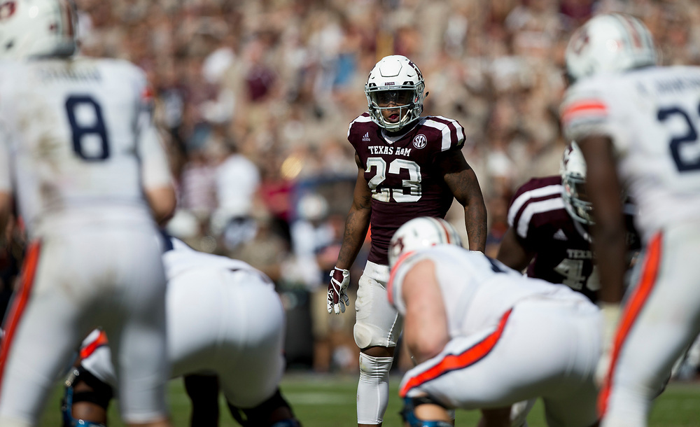 Texas A&M defensive back Armani Watts (23) spies Auburn quarterback Jarrett Stidham (8) before the start if a play during the fourth quarter of an NCAA college football game on Saturday, Nov. 4, 2017, in College Station, Texas. (AP Photo/Sam Craft)