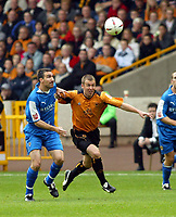 Fotball<br /> England 2004/2005<br /> Foto: SBI/Digitalsport<br /> NORWAY ONLY<br /> <br /> Wolverhampton Wanderers v Cardiff City<br /> The League Championship. 25/09/2004<br /> Kenny Miller of Wolves goes up for an aerial ball with Andy Lee of Cardiff