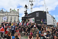 © Licensed to London News Pictures. 25/08/2021. London, UK.  Protesters take part in EXTINCTION REBELLION'S THE IMPOSSIBLE REBELLION demonstration in Piccadilly Circus. Photo credit: Ray Tang/LNP