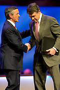 Pastor Robert Jeffress shakes hands with Texas Gov. Rick Perry at First Baptist Dallas on Sunday, April 7, 2013. (Cooper Neill/The Dallas Morning News)