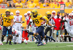 Sep 14, 2019; Morgantown, WV, USA; West Virginia Mountaineers wide receiver Sean Ryan (18) runs after a catch during the first quarter against the North Carolina State Wolfpack at Mountaineer Field at Milan Puskar Stadium. Mandatory Credit: Ben Queen-USA TODAY Sports