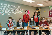 The Hancock County, KY High School Quiz Bowl Team at the end of round one, seated are, from left, Xavier Simpson, 14, an eighth-grader, Mason Dixon, 13, a seventh-grader, Alexis Gay, 13, a seventh-grader and Cameron Estes, 12, a seventh-grader. Standing behind them are substitute player Camdem Lucas, 13, a seventh-grader, and their coach, Bernice Kennedy.<br /> <br /> Teams compete in the preliminary rounds of the 2019 Kentucky Quiz Bowl Alliance Middle School State championship Saturday, April 27, 2019, at Noe Middle School in Louisville, Ky. (Photo by Brian Bohannon)