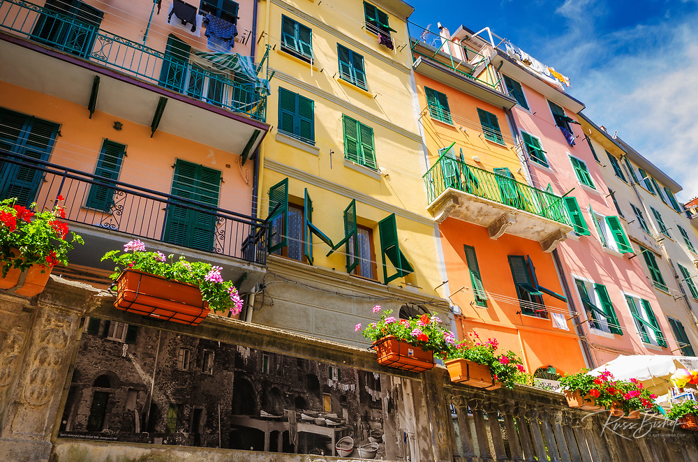 Narrow street and colorful houses in Riomaggiore, Cinque Terre, Liguria, Italy