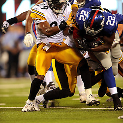 21 Aug, 2010: Pittsburgh Steelers free safety Ryan Mundy (29) tackles New York Giants running back Andre Brown (22) during second half NFL preseason action between the New York Giants and Pittsburgh Steelers at New Meadowlands Stadium in East Rutherford, New Jersey. The Steelers beat the Giants 24-17.