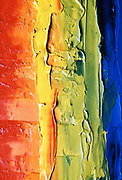 Abstract rainbow created with stripes of paint on canvas