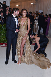 Brdley Cooper and Irina Shayk walking the red carpet at The Metropolitan Museum of Art Costume Institute Benefit celebrating the opening of Heavenly Bodies : Fashion and the Catholic Imagination held at The Metropolitan Museum of Art  in New York, NY, on May 7, 2018. (Photo by Anthony Behar/Sipa USA)