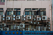 Wall mounted air conditioning units behind a building in Hong Kong.  (photo by Andrew Aitchison / In pictures via Getty Images)