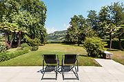 patio of a villa, modern furniture, two sun lounger