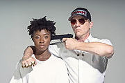 """Actor portraying a """"Trump Supporter"""" looking like he wants to kill the black woman that his brass knuckled hand is wrapped around.  These actors all complied to be part of this creation and does not in any way suggest their actions are true."""
