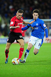 Cardiff City's Craig Bellamy is chased down by Peterborough United captain, Tommy Rowe - Photo mandatory by-line: Dougie Allward/JMP  - Tel: Mobile:07966 386802 15/12/2012 - SPORT - FOOTBALL -  Championship -  Cardiff-  New Cardiff City Stadium  -  Cardiff City v Peterborough United