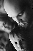 Adam Pratt holding Jamison Pratt. Shot on black and white film.
