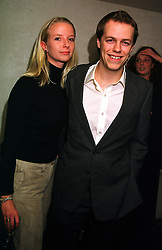 MISS ABIGAIL WALTERS and MR TOM PARKER BOWLES son of Camilla Parker Bowles,  at a party in London on 2nd November 1999.MYL 55