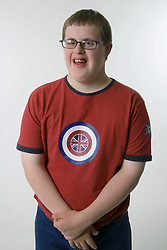 Boy with Down's Syndrome; smiling,