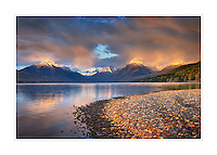 Lake McDonald as a passing storm glows in the evening light, Glacier National Park Montana USA