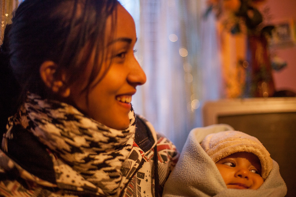Jana, 23 year old wife of Emil (20) with their new born child in the selfconstructed house in Rankovce (01/2016). The young family corporates with the foundation ETP Slovakia which has a project in Rankovce setting up micro-loan funds for the local Roma community. Loans from this fund enabled families to build their own low-cost brick homes, on land they own.