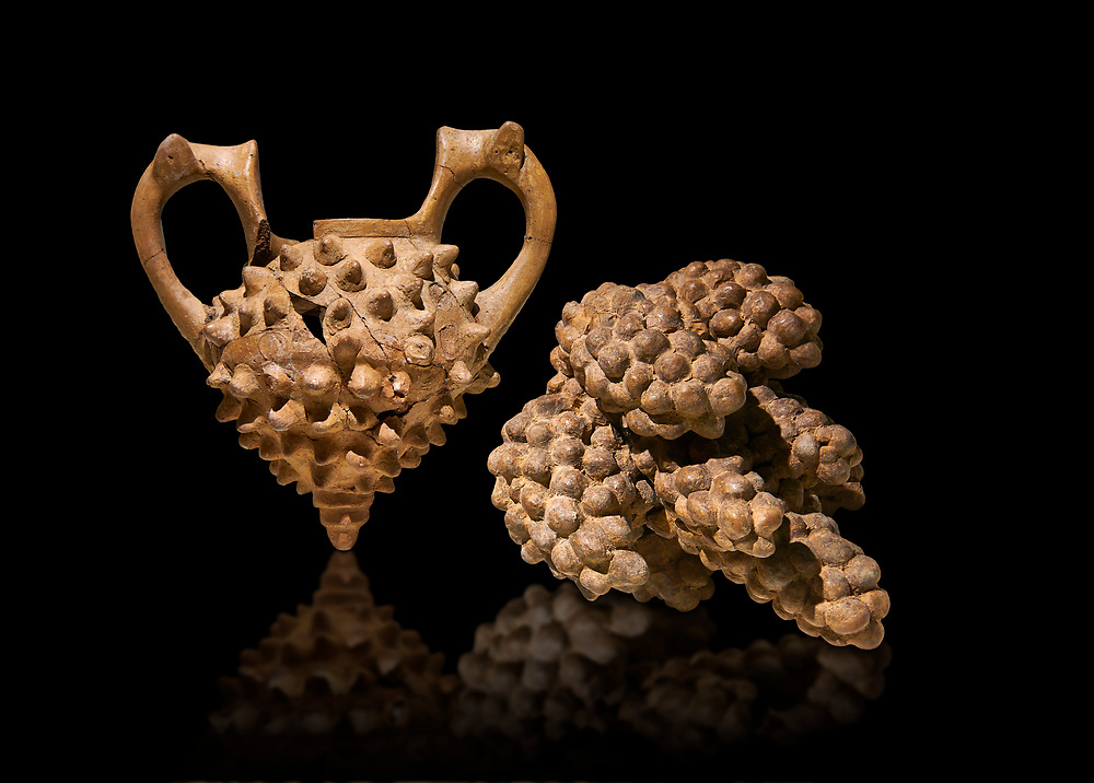 Hittite terra cotta two handled vessel and a ritual vessel in the shape of a bunch of grapes - 16th century BC - Hattusa ( Bogazkoy ) - Museum of Anatolian Civilisations, Ankara, Turkey . Against black background .<br /> <br /> If you prefer to buy from our ALAMY STOCK LIBRARY page at https://www.alamy.com/portfolio/paul-williams-funkystock/hittite-art-antiquities.html  - Type Hattusa into the LOWER SEARCH WITHIN GALLERY box. Refine search by adding background colour, place, museum etc<br /> <br /> Visit our HITTITE PHOTO COLLECTIONS for more photos to download or buy as wall art prints https://funkystock.photoshelter.com/gallery-collection/The-Hittites-Art-Artefacts-Antiquities-Historic-Sites-Pictures-Images-of/C0000NUBSMhSc3Oo