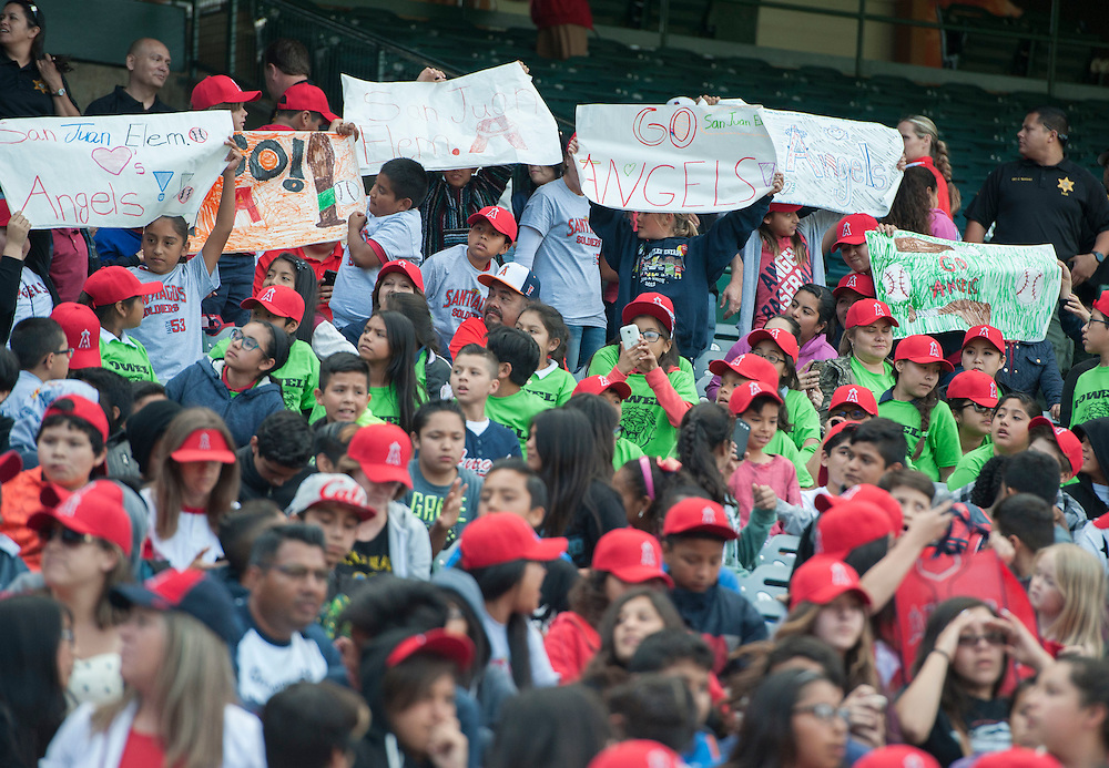 Hundreds of at-risk students show their support for the Angels during the Orange County Gang Reduction and Intervention Partnership Angels game Tuesday. The visit is a reward for improved school attendance and behavior and for staying out of gangs.<br /> <br /> <br /> ///ADDITIONAL INFO:   <br /> <br /> angels.0427.kjs-pre  ---  Photo by KEVIN SULLIVAN / Orange County Register  --  4/26/16<br /> <br /> The Los Angeles Angels take on the Kansas City Royals Tuesday at Angel Stadium.<br /> <br /> <br />  4/26/16