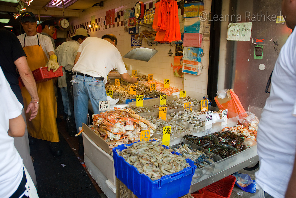 In Soho fresh shellfish is sold in a streetside market, New York City.
