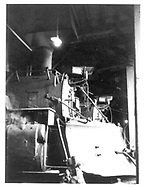 An engineer's-side smokebox view of D&RGW #487 (with a pilot plow) and #483 in Durango roundhouse.<br /> D&RGW  Durango, CO
