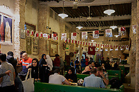 Doha ,Qatar -December 26 , 2019 : people tourists having diner in a tradiotional  restaurant of Souq Waqif  main touristic place