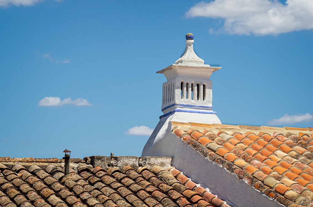 Image of a Chimney with Roof Tiles in the village of Cacela Velha.